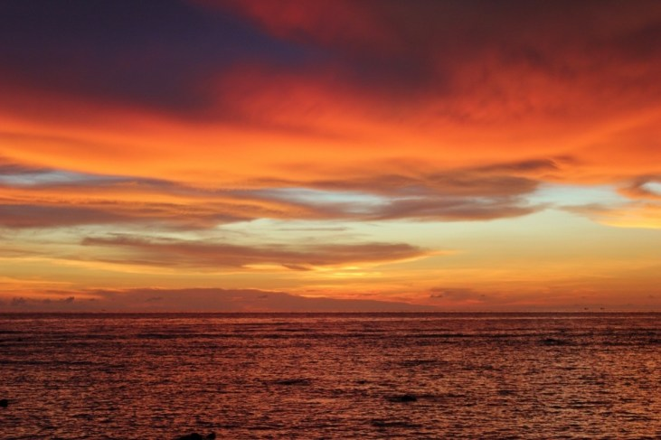Orange sunset with clouds on Klong Khong Beach in Koh Lanta, Thailand