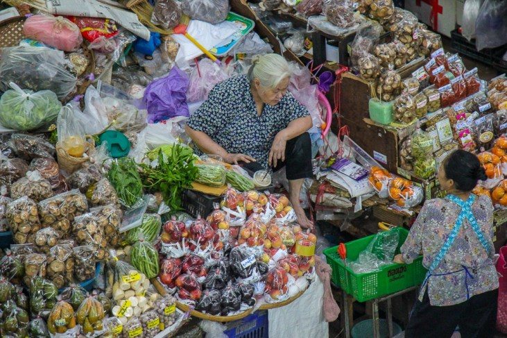 Woman vendor selling goods at Ton Lam Yai Market in Chiang Mai, Thailand
