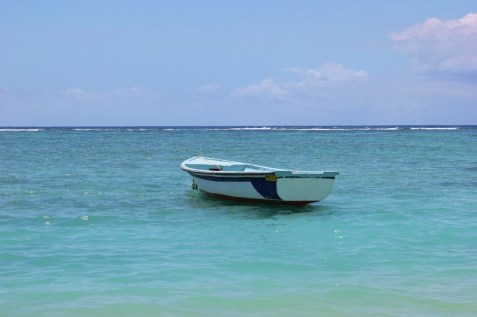 Rowboat bobbing on the sea in Flic en Flac, Mauritius