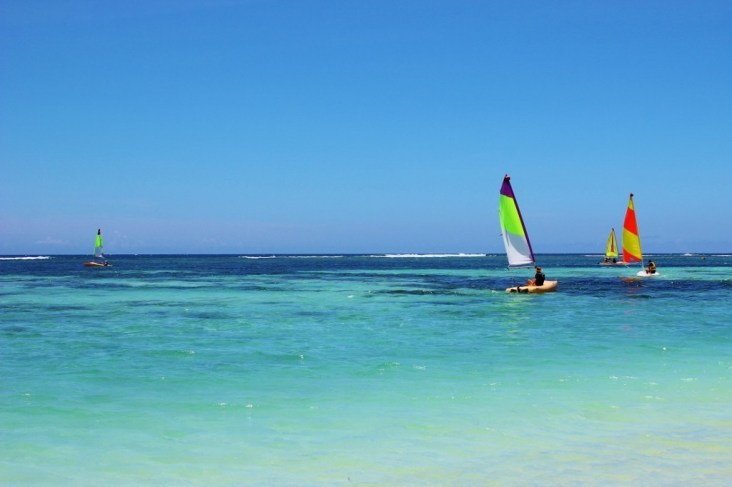 Windsurfer in Indian Ocean at Flic en Flac Beach in Mauritius