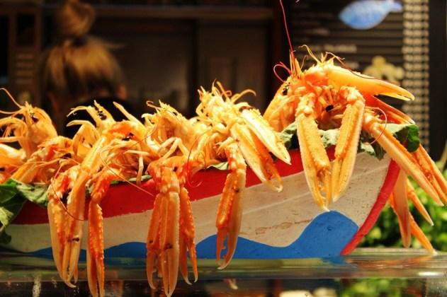 Displayed fresh seafood at La Boqueria Market in Barcelona, Spain