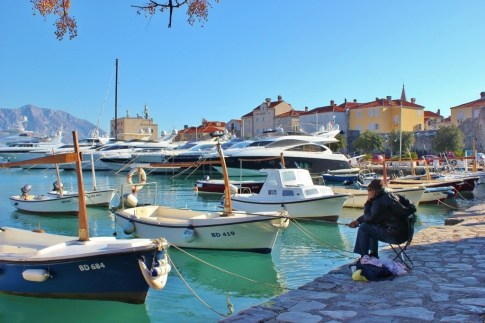 Budva Harbor and a lone fisherman