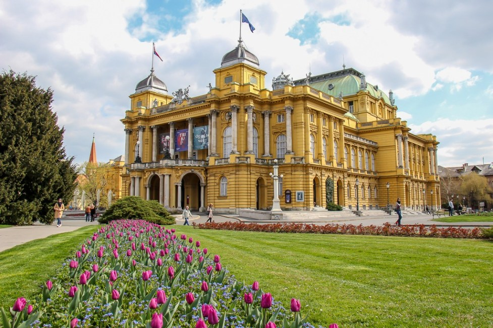 Flowers line walkway to Croatia National Theater in Zagreb, Croatia
