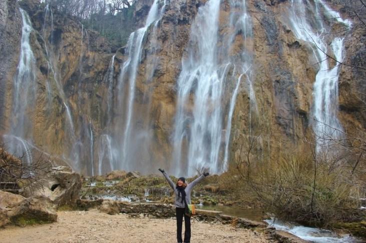 Sarah standing at base of Veliki Slap (Big Waterfall)