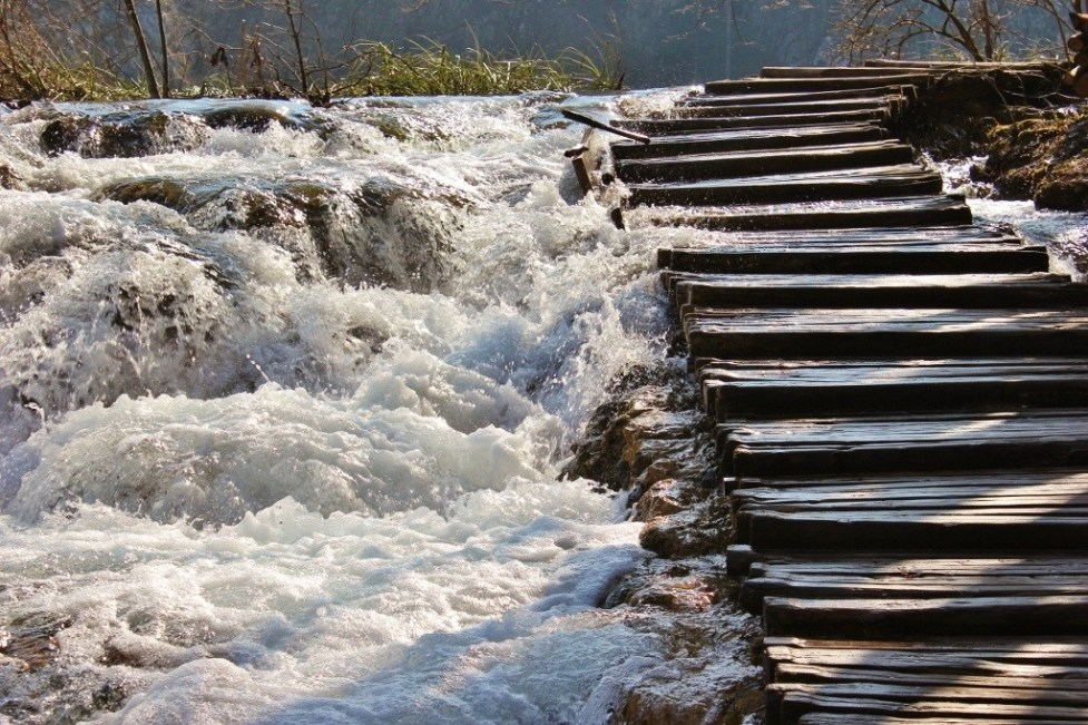 Wooden stairs next to stream at Plitvice Lakes National Park in Croatia