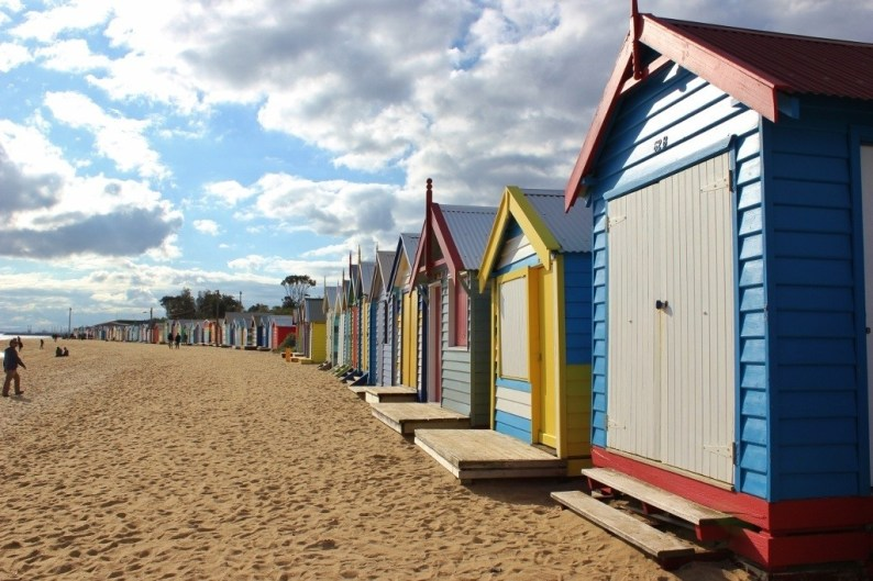 Brighton Beach Bathing Boxes are uniform in size and materials used and are situated in a single line.