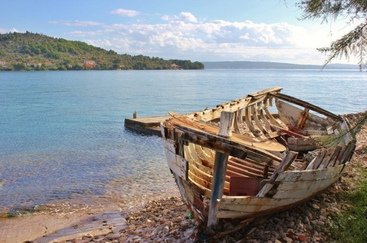 A boat skeleton on the shore in Preko on Ugljan, Croatia