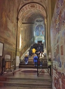 Pilgrims climb Holy Stairs on their knees in Rome, Italy