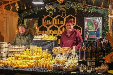 Two women sell homemade goods from booth at Kleve Christmas Market in Germany