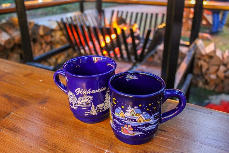 Two glasses of Gluhwein by fire at Klever Christmas Market in Germany