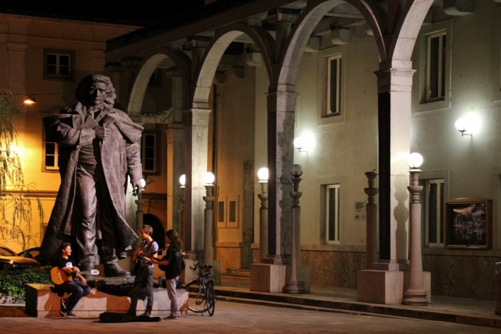 Musicians practice at Dr. Frances Preseren Statue, Kranj, Slovenia at night
