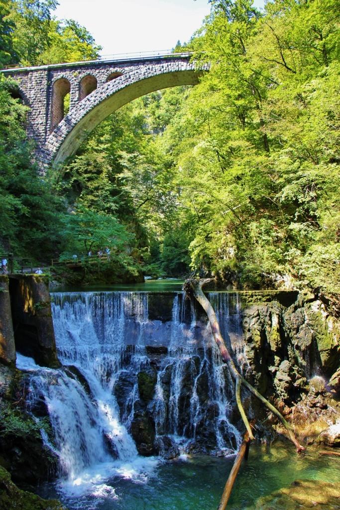 Stone arch train bridge over dam in Vintgar Gorge Slovenia