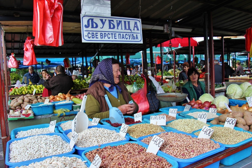 Woman sells beans at Green Market in Belgrade, Serbia