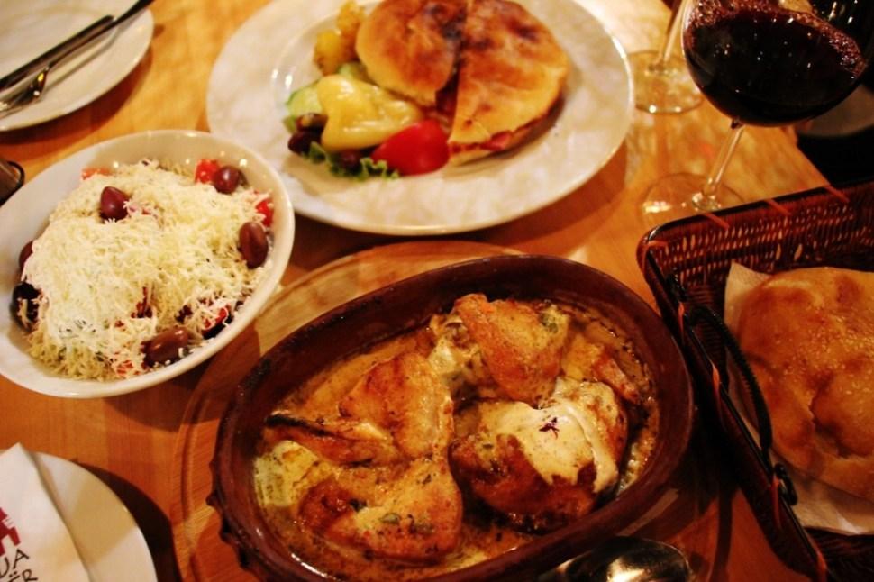 Chicken dish and shopska salad at Shpija e Vjeter restaurant in Prishtina, Kosovo