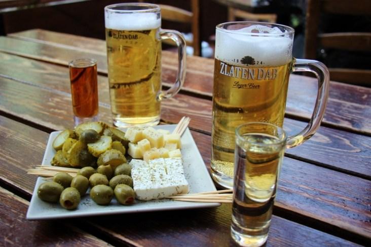 Rakija shots, Zlaten Dab beer and cheese plate at Rakija Bar Kaldrma, Skopje, Macedonia