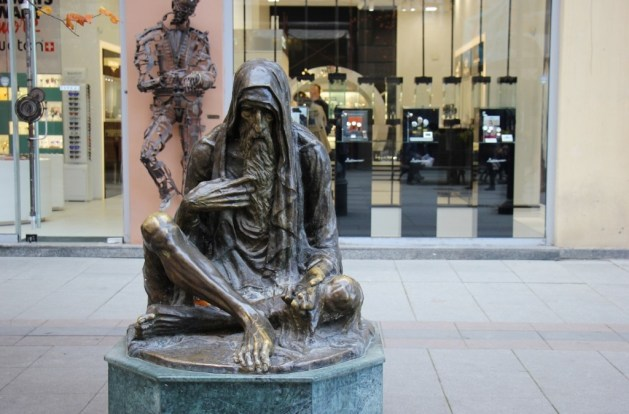 Statue of Beggar in front of high-end store, Skopje, Macedonia