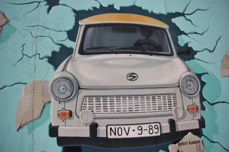 The East Side Gallery mural artwork on remaining Berlin Wall in Berlin, Germany