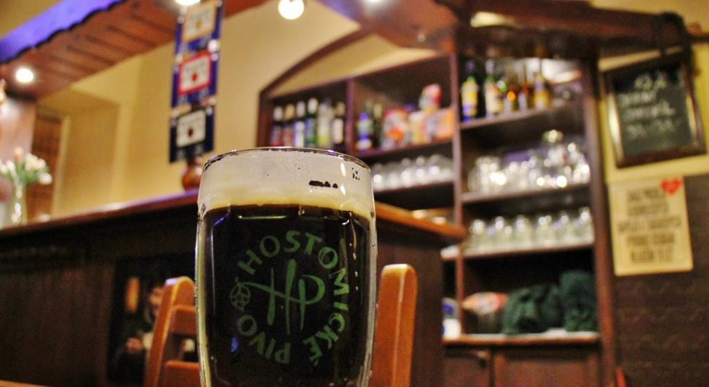 Mug of dark beer at Pivovar Hostomice taproom in Prague, Czech Republic