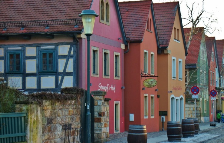 Colorful shops and pubs line main street in Altkotzschenbroda near Dresden, Germany
