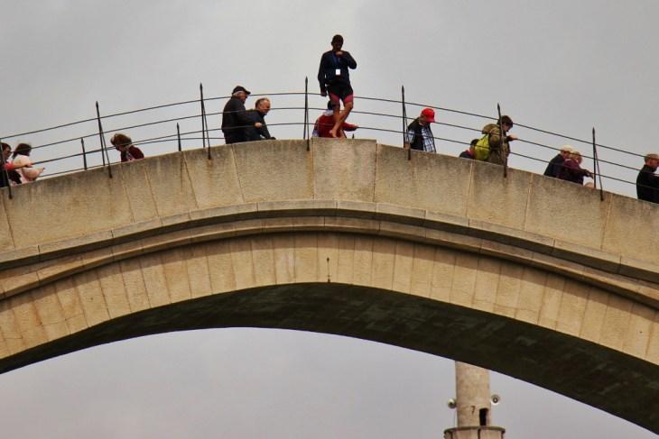 Diver stands on Old Bridge in Mostar, Bosnia-Herzegovina