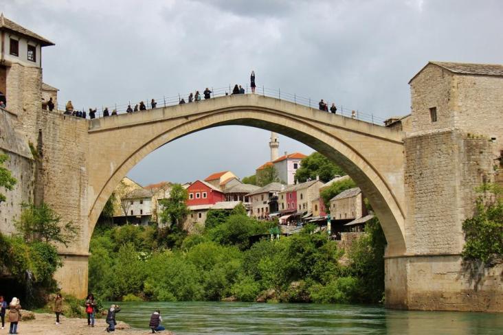 Diver preparing to jump from the Old Bridge in Mostar, Bosnia-Herzegovina