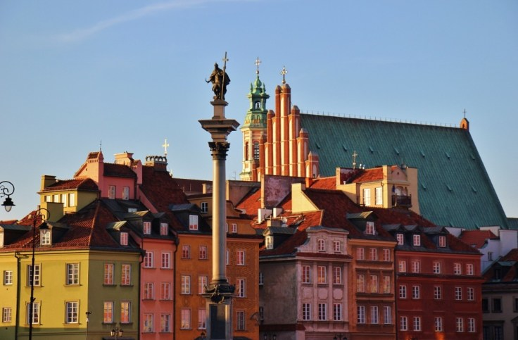 Sunset on Royal Square, King Sigismund's Column and the Old Town in Warsaw, Poland