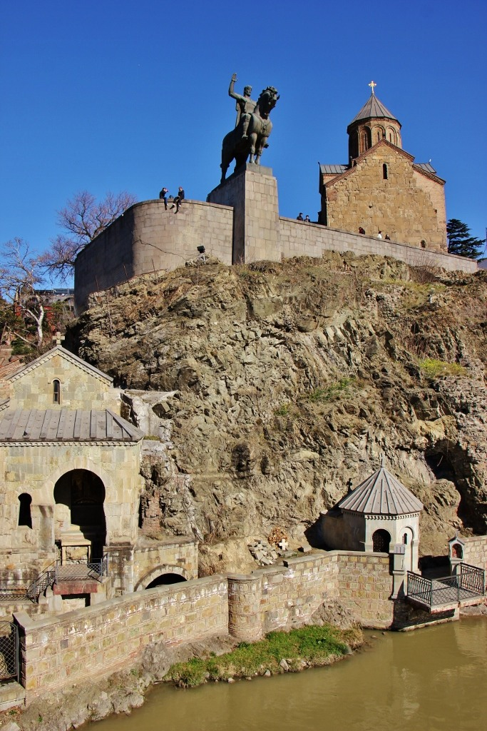 Metekhi Church of Assumption and King Vakhtang Gorgasali Statue on cliff over river in Tbilisi, Georgia