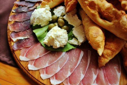 Platter of traditional cured meats, cheese and bread at mountain restaurant near Mostar, Bosnia-Herzegovina