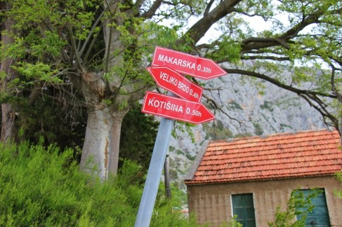 Red arrow trail signs on Biokovo Mountain Range, Makarska, Croatia