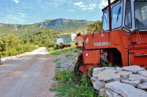 Trail marker painted on tractor on Vidova Gora hike on on Brac, Croatia