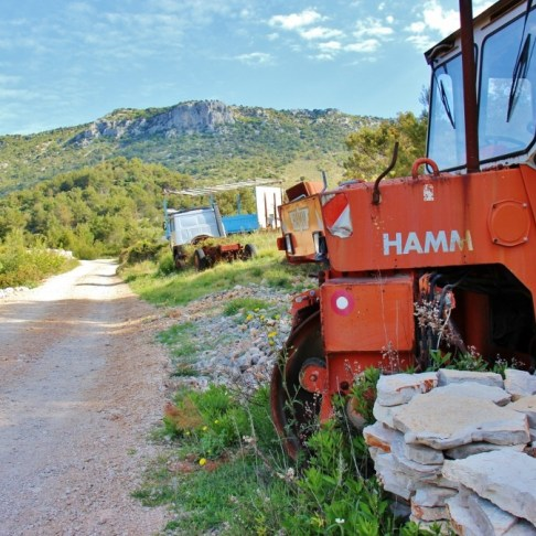 Trail marker painted on tractor on Vidova Gora hike on on Brac, Croatia