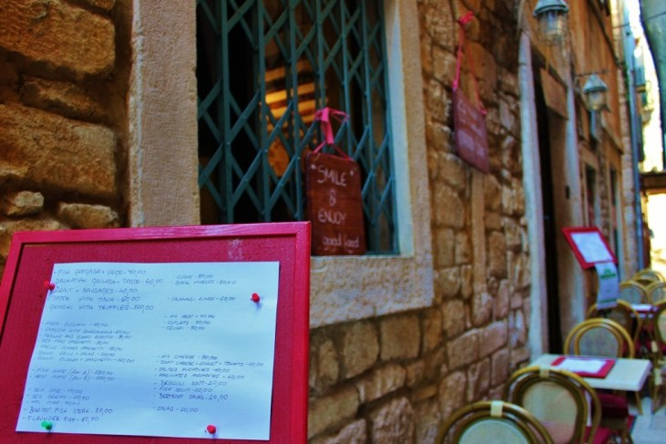 Daily menu and outdoor tables at Trattoria Bajamont in Split, Croatia