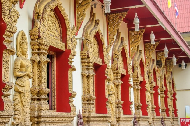 Gilded arched windows at Pan On Temple in Chiang Mai, Thailand