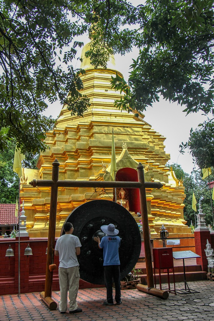 Large gong and stupa at Pan On Temple in Chiang Mai, Thailand