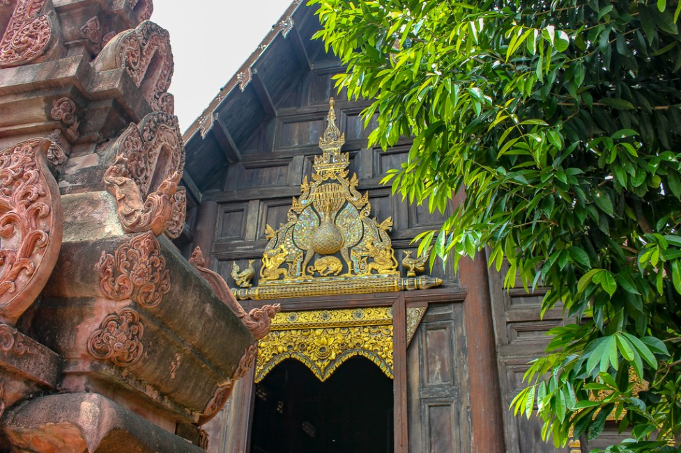 Ornate portico over entrance to Wat Phan Tao in Chiang Mai, Thailand