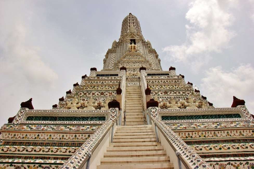 Central Prang (tower) decorated in ceramic tiles at Wat Arun in Bangkok, Thailand