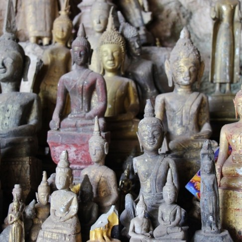 Dusty Buddha statues in Pak Ou Caves, Buddha Cave, Laos