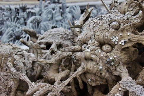 Creepy carvings and sculptures at the White Temple in Chiang Rai, Thailand