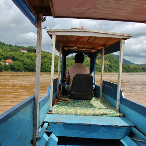 Riding a Mekong River taxi boat in Luang Prabang, Laos