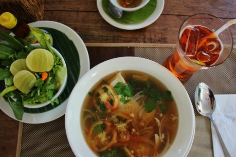 Noodle soup with fresh vegetables and sweet tea in Luang Prabang, Laos
