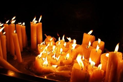 Lit candles in Stone Gate Chapel in Zagreb, Croatia