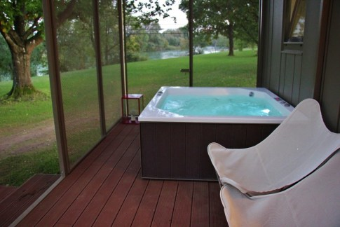 Hot tub on patio of Big Berry Glamping hut in Bela Krajina, Slovenia