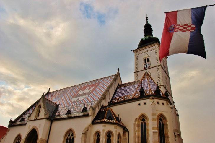 Croatian flag flying over St. Mark's Church Zagreb in Zagreb, Croatia