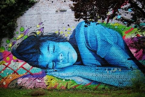 Sleeping girl street art mural at Medika in Zagreb, Croatia