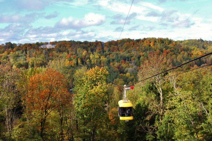 Yellow cable car on Air Cableway in Sigulda, Latvia