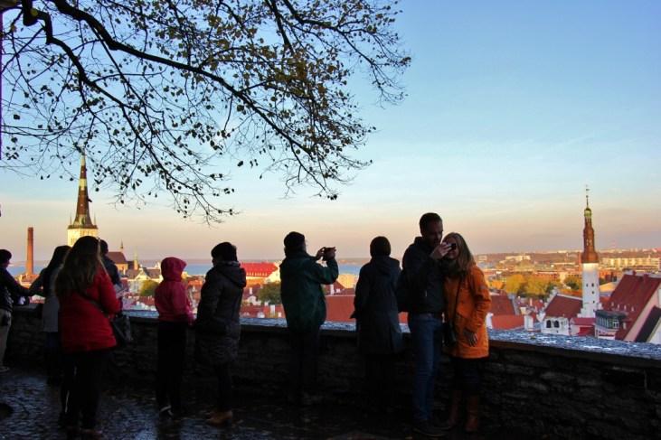 Visitors take photos from Kohtu Street viewing platform on Toompea Hill in Tallinn, Estonia