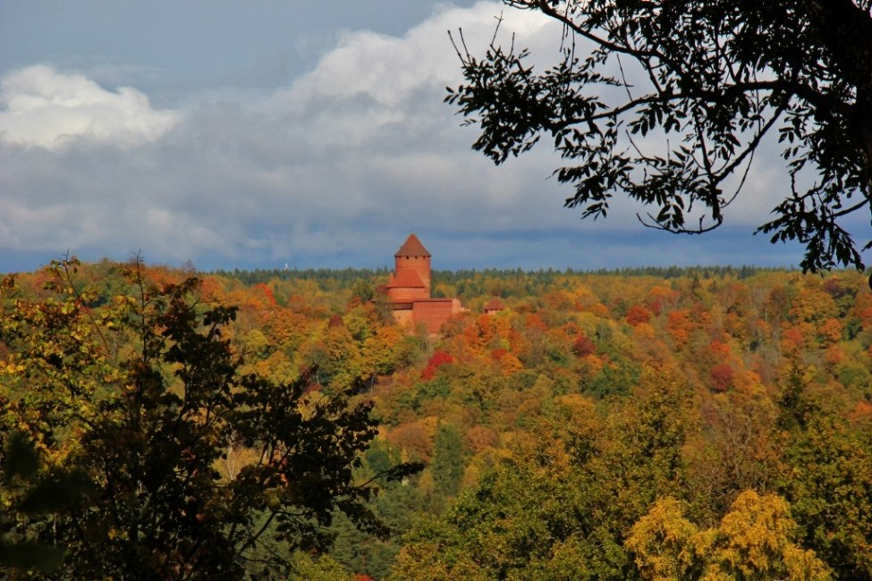 Turaida Castle above the tree line in autumn in Sigulda, Latvia