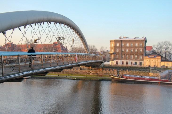 Crossing the Bernatek Pedestrian Bridge connecting Podgorze and Kazimierz in Krakow, Poland