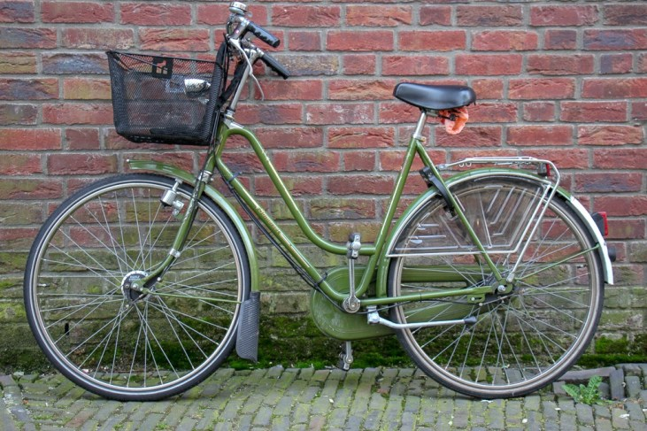 Bicycle rests against brick wall in Haarlem, Netherlands