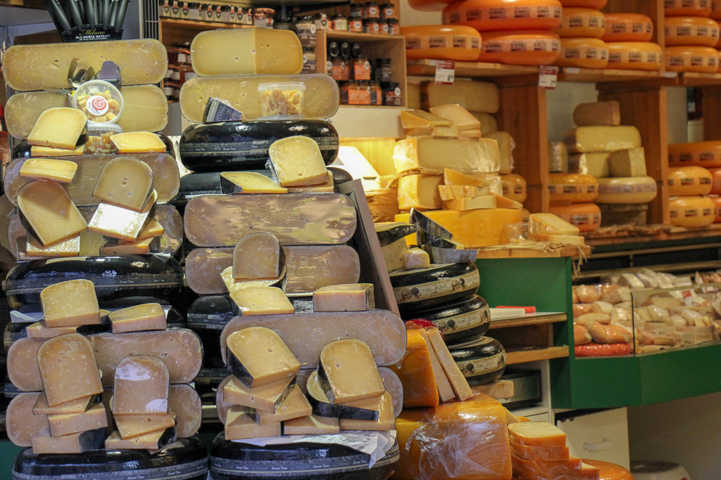 Stacked cheese rounds at cheese shop in Haarlem, Netherlands